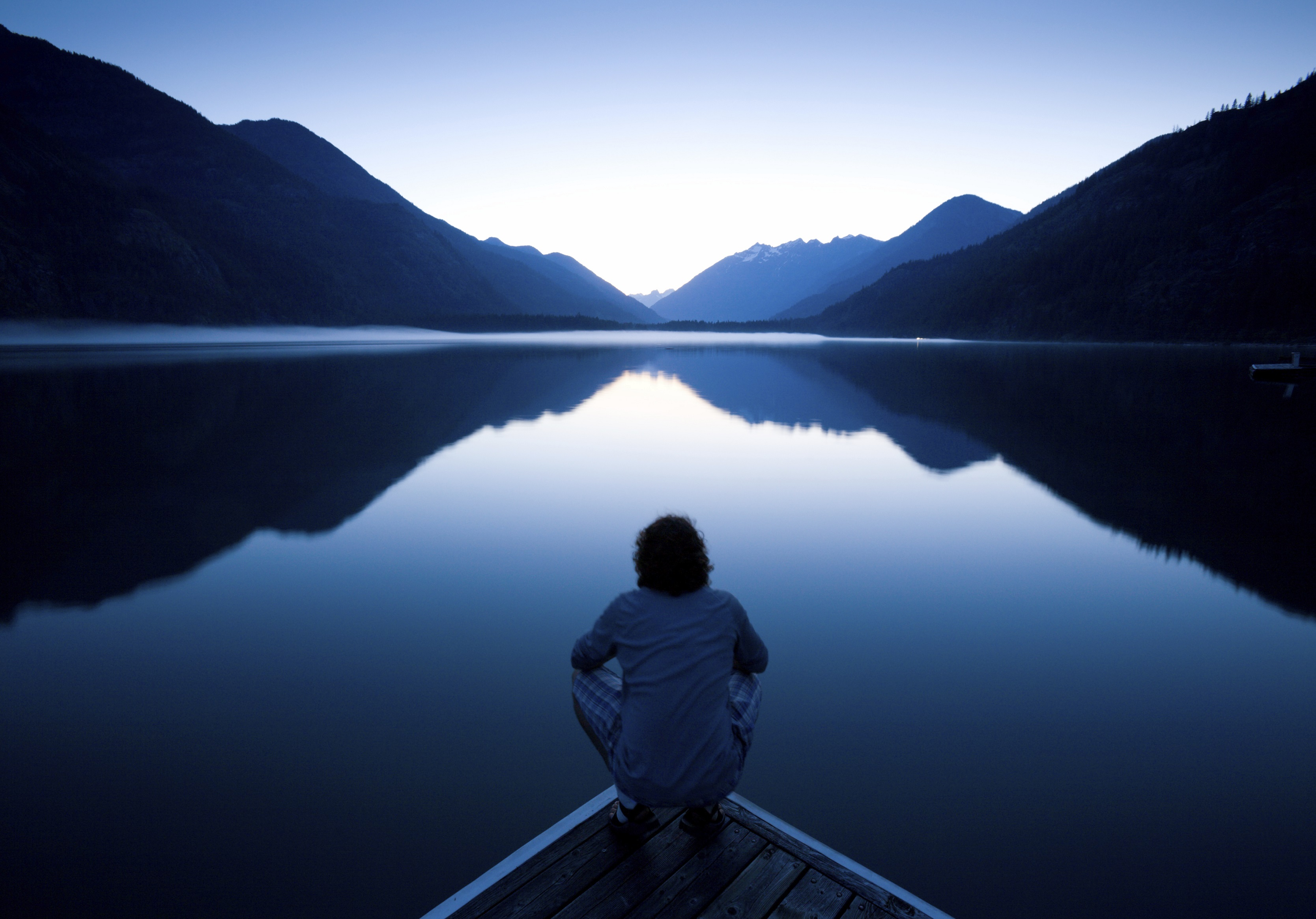 Person looking at lake and mountains